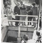Dedication ceremony at Oat Hills Tunnel, releasing water into the San Diego Aqueduct. Left to Right: Chairman Fred A. Heilbron, Water Authority; D.E. Howell, San Diego County; E.G. Nielsen, Bureau of Reclamation; Chairman Joseph Jensen, Metropolitan Water District; Capt. C.W. Porter, U.S. Navy. Extreme left: General Manager and Chief Engineer Richard S. Holmgren observing removal of bulkhead. Photo: SDCWA Archives