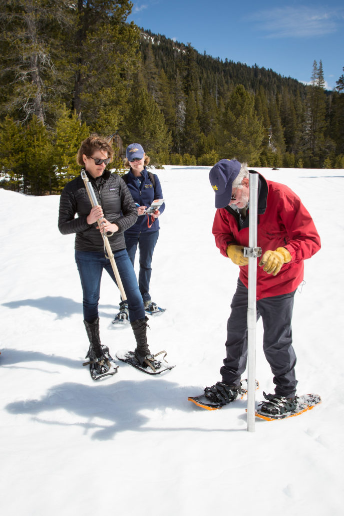 Karla Nemeth, Director of the California Department of Water Resources, left, Cindy Messer, Chief Deputy Director (DWR), center, assists Frank Gehrke, Chief of the California Cooperative Snow Surveys Program, with the fourth snow survey of 2018 at Phillips Station in the Sierra Nevada Mountains. The survey site is approximately 90 miles east of Sacramento off Highway 50 in El Dorado County. Photo: Dale Kolke / California Department of Water Resources low snowpack