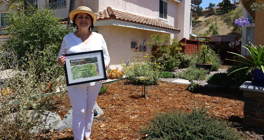 "Former water conservation class graduate and rebate recipient Rosalba Ponce from Chula Vista was named the Otay Water District's 2018 winner for ""Best in District."" Photo: Courtesy Otay Water District Landscape Makeover"