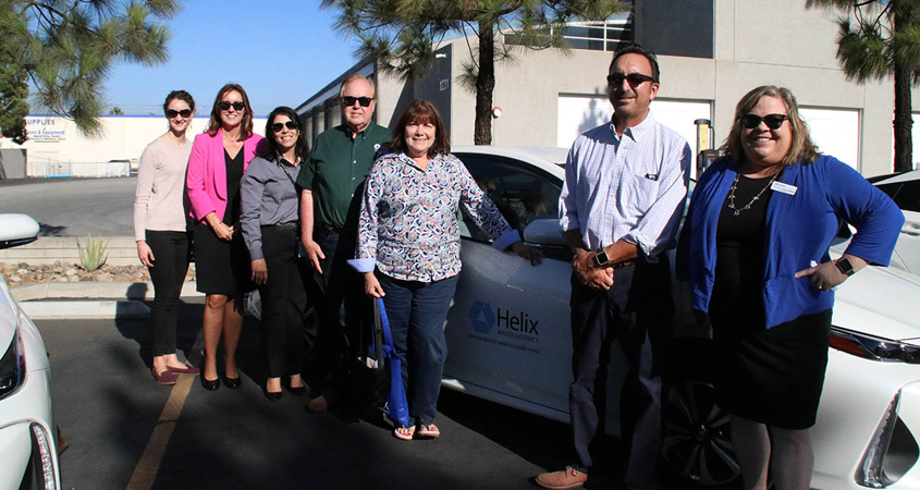 Front to back: Helix board president Kathleen Hedberg, Helix director Mark Gracyk, Lemon Grove councilwoman Jennifer Mendoza, Helix director Dan McMillan, El Cajon deputy director of public works Yazmin Arellano, SDG&E electric vehicle customer solutions manager Lianna Rios and La Mesa analyst Jenny Lybeck. Arellano and Lybeck manage their city's climate action plan. Photo: Courtesy Helix Water District