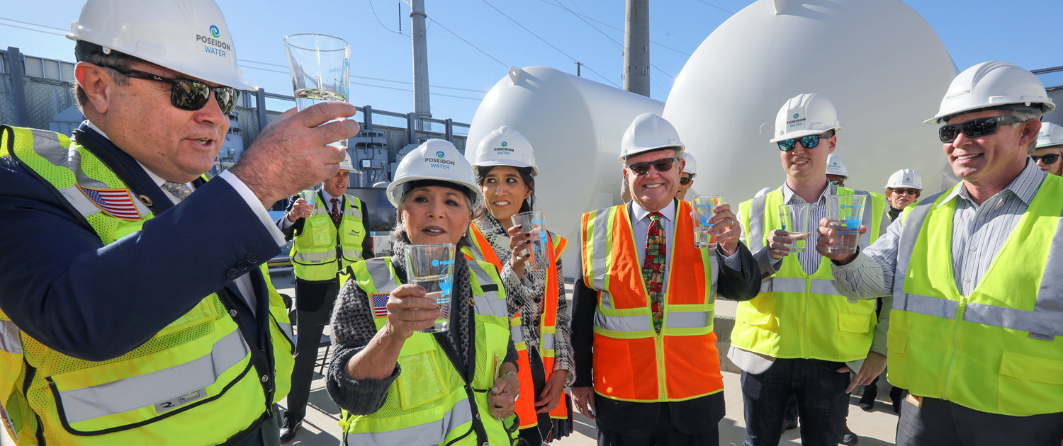 (L to R) Carlos Riva, former Sen. Barbara Boxer, Carlsbad Mayor and Water Authority Board Member Matt Hall toast the desalination plant's third anniversary. Photo: Water Authority