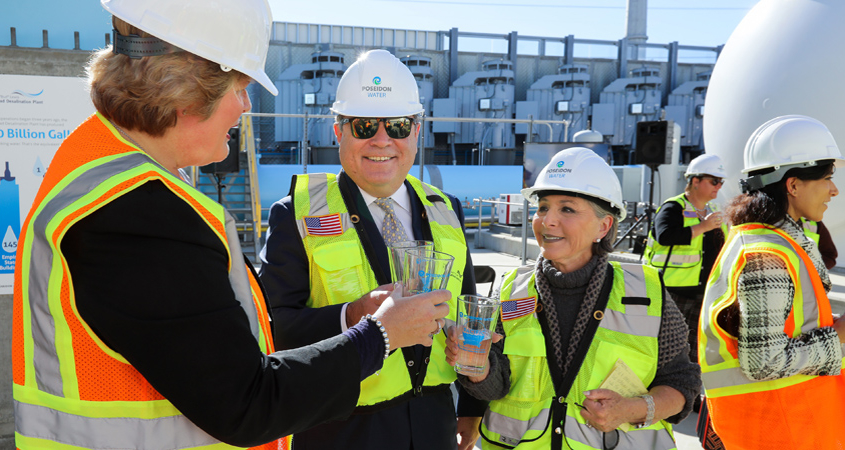 L to R: Water Authority Deputy General Manager Sandra Kerl, Poseidon Water CEO Carlos Riva, and former Senator Barbara Boxer share a toast at Thursday's third anniversary event at the Carlsbad desalination plant. Photo: Water Authority