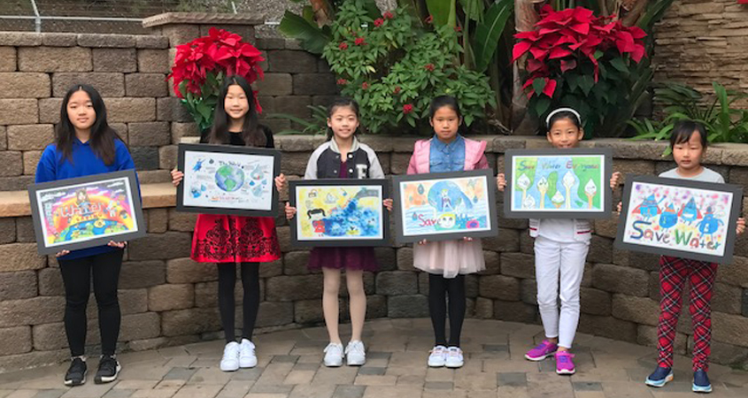 (L to R) 2019 poster contest winners Madelieine Inawen, Claire Zhang, Kate hu, Alanis Huang, and Weiyi Xu with their winning artwork. Photo: Courtesy City of San Diego