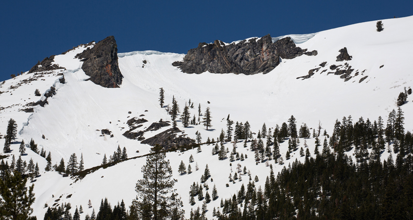 A snow-covered Sierra Nevada Mountain peak to the northwest from the Phillips Station meadow season. Photo: Dale Kolke / California Department of Water Resources snowmelt