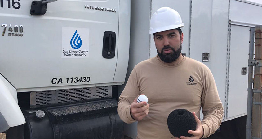 Water Resources Engineer Sami Sweis holds the Nautilus in his right hand and a foam ball in his left hand that the high-tech device is placed in before it is inserted into a water pipeline to scan for potential leaks. Photo: Water Authority