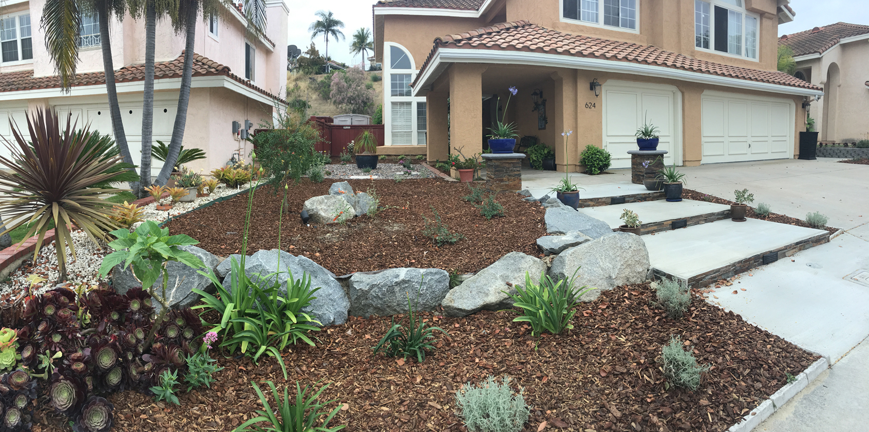 Boulders can add points of interest and slow down water runoff in your landscaping. Photo: Water Authority