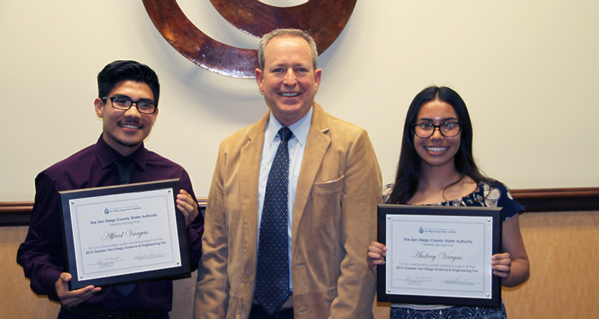 Alfred and Audrey Vargas with Water Authority Board Chair Jim Madaffer after they were awarded first place in the Greater San Diego Science and Engineering Fair for designing a device that could treat wastewater and generate electricity. Photo: Water Authority