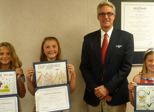 OMWD Board President Ed Sprague with 2019 poster contest winners (L to R) Sayla Egger, Addison Bowe, and Delaney Owens. Photo: OMWD Water Awareness