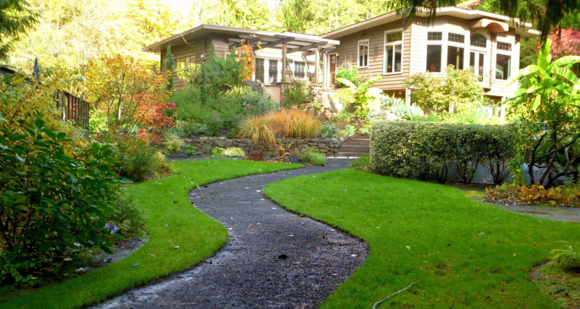 Sometimes a portion of lawn is maintained even with sustainable landscaping plans, and using the right type of grass, along with proper care, can reduce water needs. Image: Inspector/Pixabay