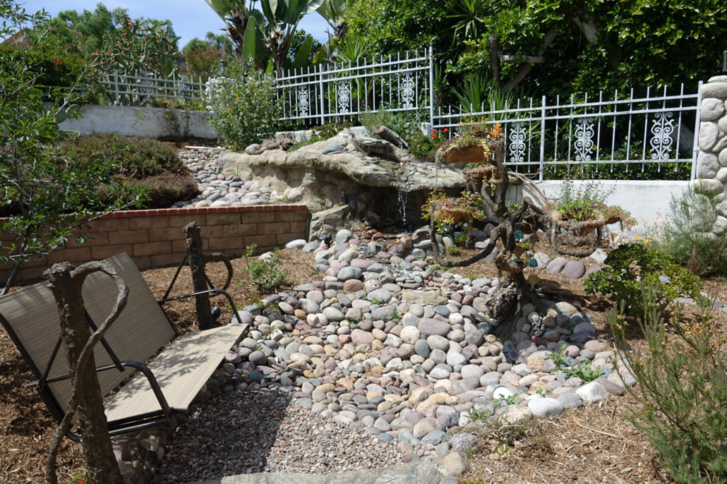 Water from the waterfall grotto travels up the faux bonsai tree in the Cissells' La Mesa Conservation Garden. Photo: Otay Water District