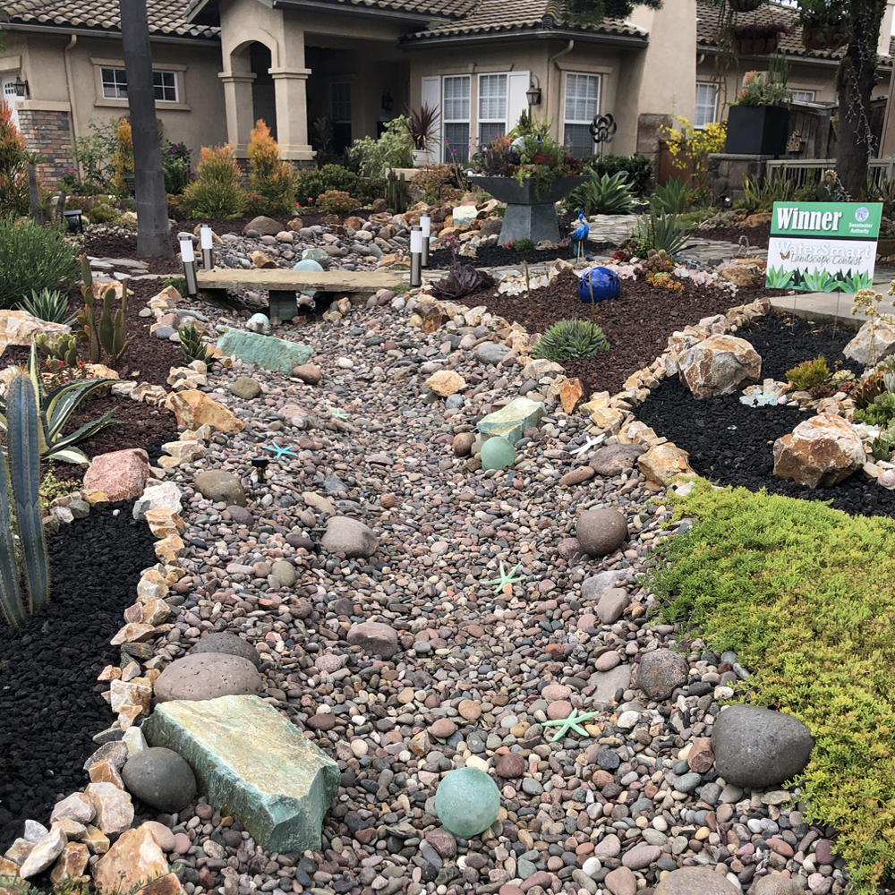Channels can be planted or lined with rocks and small boulders to resemble natural creek beds.
