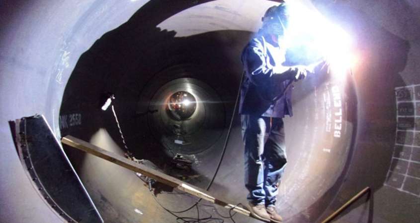 A welder works inside the pipe to connect the new joints. Photo: Water Authority
