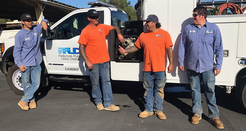 L to R: Colter Shannon, Toby Stoneburner, Matt Perez, and Austin Wendt, stand in front of the utility vehicle they will take to Paradise, Calif. to help with water repairs from November's treacherous Camp Fire. Photo: FPUD