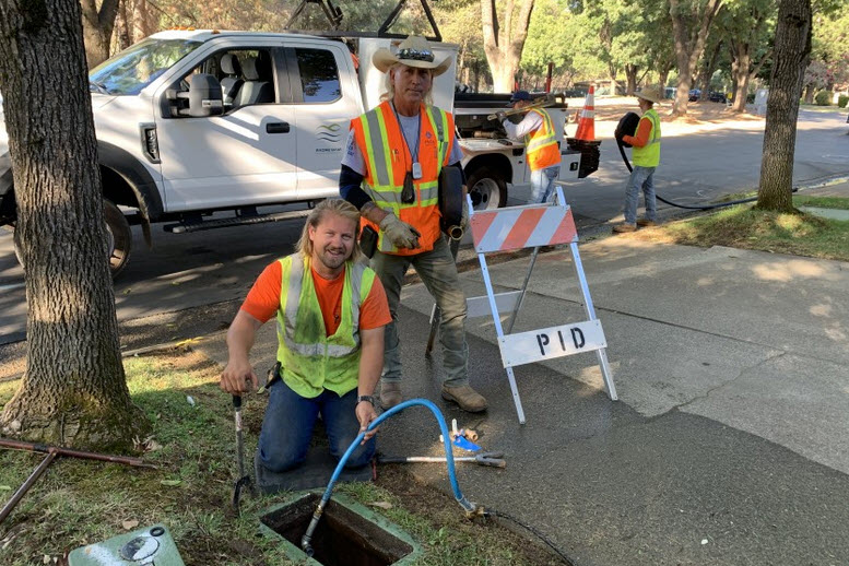 Austin Darley and Jesse Knowles hard at work in Paradise, California. Photo: Padre Dam Municipal Water District