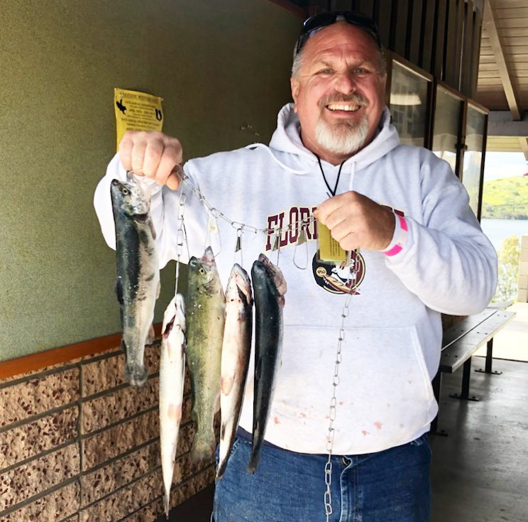 Brian Pierce of El Cajon caught his limit of trout at Lake Jennings in March, and planned to return for the opening of fall trout season 2019 last weekend. Photo: Helix Water District