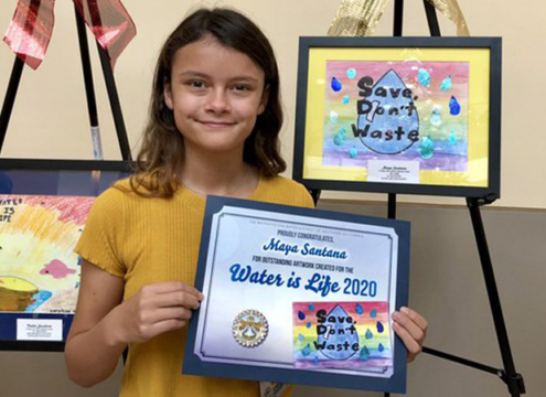 Calendar poster contest winner Maya Santana, a fifth grader from Wolf Canyon Elementary School in the Otay Water District, displays her winning artwork. Photo: Otay Water District Water Is Life Calendar