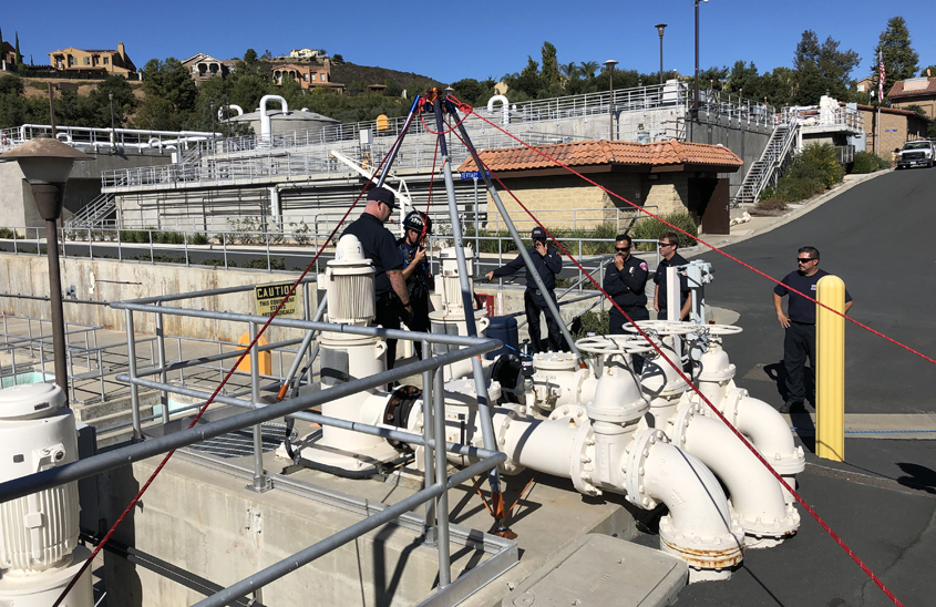 Firefighters are briefed on scene at the Meadowlark Reclamation Facility as part of confined space training drills conducted with the Vallecitos Water District. Photo: Vallecitos Water District safety practices