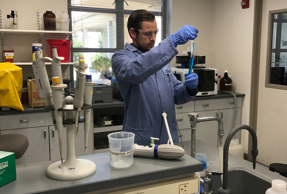 Brett Kelley conducts a test in the City of Escondido Water Quality Lab. Photo: City of Escondido