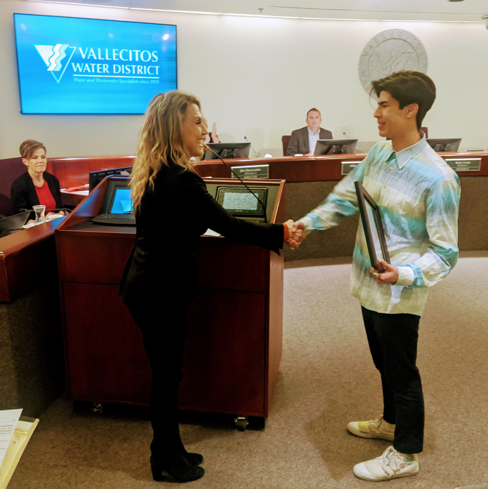 San Marcos Mayor Rebecca Jones presents winner Jordan Chan with a certificate of appreciation at the Vallecitos Water District's February board meeting. Photo: VWD
