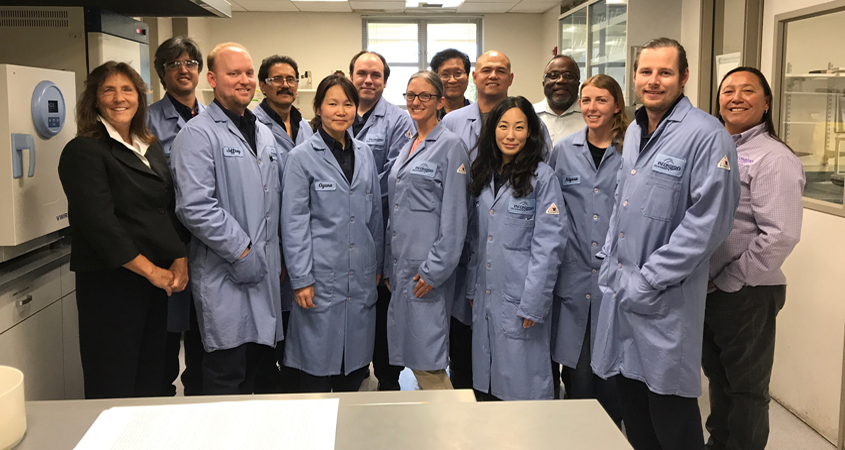 Oyuna Jenkins (fifth from left) and the 14 person Escondido Water Quality Lab team, one of only two certified labs in California under new water quality standards. Photo: City of Escondido California Laboratory Person