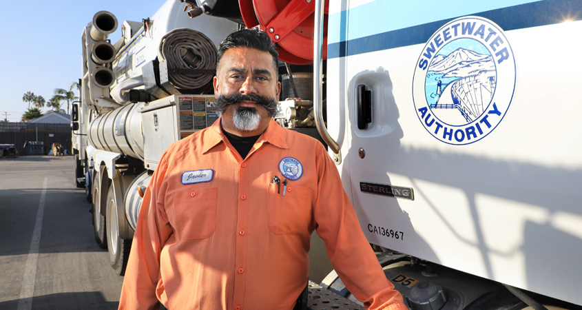"""""""The desire to produce quality work and to know that customers can depend on us is what motivates me,"""" said Sweetwater Authority Field Crew Supervisor Javier Natividad. Photo: Water Authority water pros working"""
