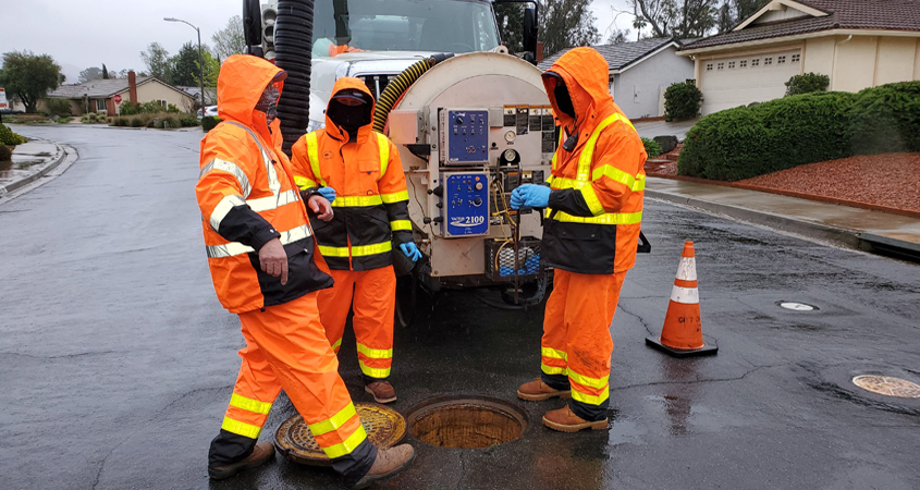 (L to R): Terry Zaragoza, Chad Weigel and Vernon Fitzpatrick from the City of Poway perform routine maintenance on a wastewater pipeline as essential employees. Photo: City of Poway