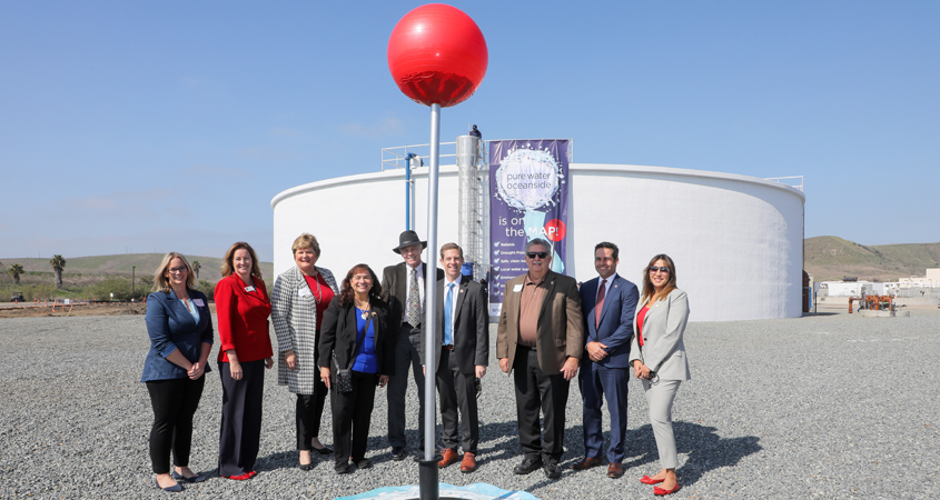 """Oceanside city leaders and water experts placed a giant Google Maps """"location pin"""" into the ground at the San Luis Rey Water Reclamation Facility in February, which officially marked the new recycled water project on the map. Photo: San Diego County Water Authority Oceanside wins"""