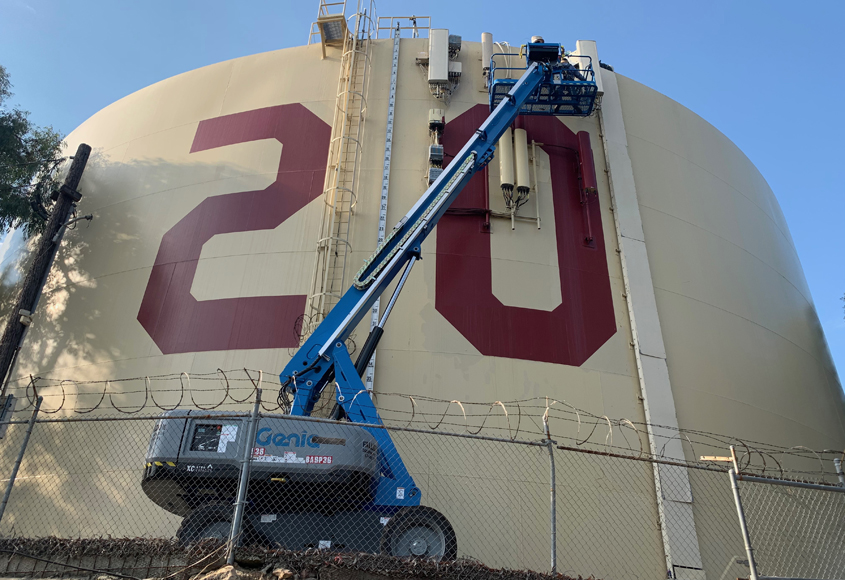 Fallbrook Public Utility District utility workers Colter Shannon and Bryan Wagner do the honors changing the painted numbers on Rattlesnake Tank for the Class of 2021. Photo: Fallbrook Public Utility District