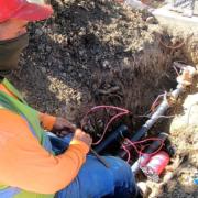 Brian Idekler of O'Connell Landscape Maintenance installs a flow control sensor for the San Elijo HOA. Photo: Vallecitos Water District