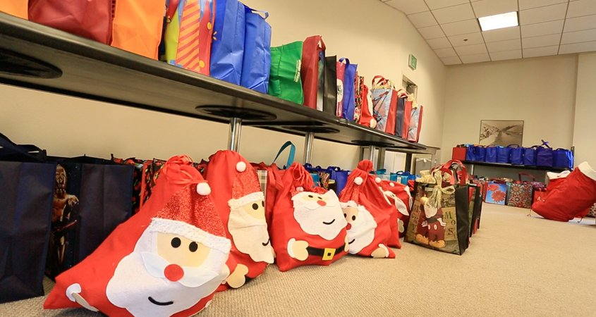 "City of Escondido employees participate in the annual ""PJ Angels"" program. New pajamas are collected for multiple local agencies serving children in crisis. photo; city of Escondido Holiday giving"
