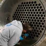 A Helix staff member installs parts in the ozone generator. Photo: Helix Water District