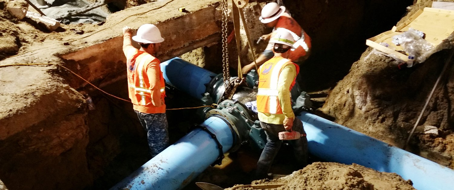 City of San Diego public utilities crew members replace an aging cast iron water pipe at 5th and Robinson in Hillcrest. Photo: City of San Diego