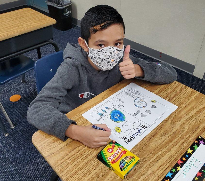 Live Oak Elementary student Edgar Campos enjoys the creative process. Photo: Fallbrook PUD