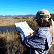 Naturalists Paige DeCino (left) and Karen Merrill survey South Lake Reservoir. Photo: Vallecitos Water District