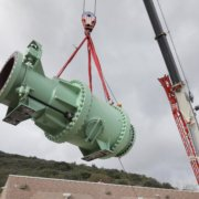 Crane lifts valve from roof