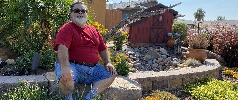 Homeowner Frank Edward displays his award-winning landscape. Photo: Padre Dam MWD Padre Dam Landscape Makeover