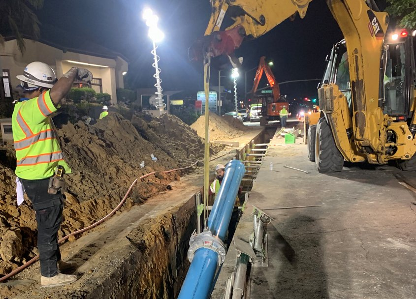 Lowering a section of the new potable water pipe into a trench in El Camino Real joint project by OlivenhainLowering a section of the new potable water pipe into a trench in El Camino Real joint project by Olivenhain